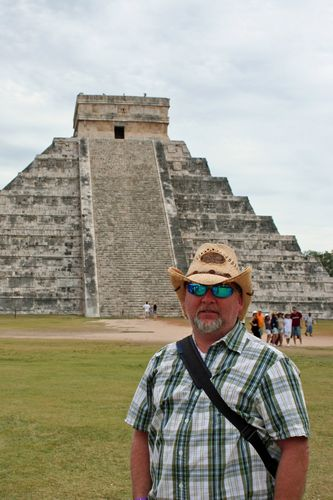 image of man in front of the pyramid at Chichen Itza in Mexico