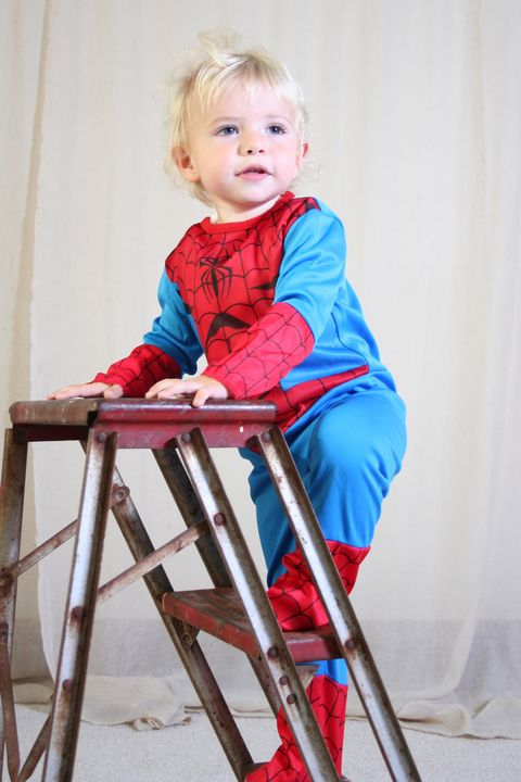 image of a toddler on ladder