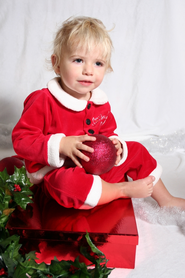 image of little boy in red christmas outfit