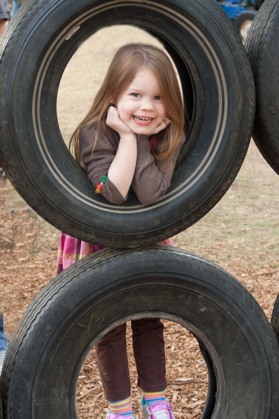 image of a girl framed by a tire