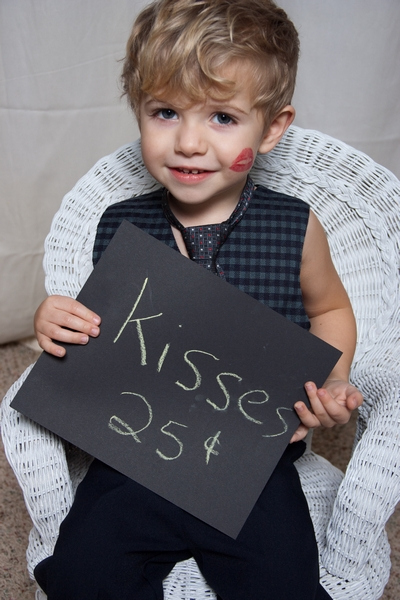 image of little boy holding a valentine sign