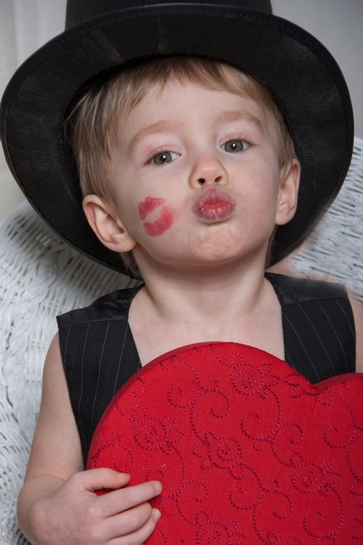 image of little boy waiting for a valentine kiss
