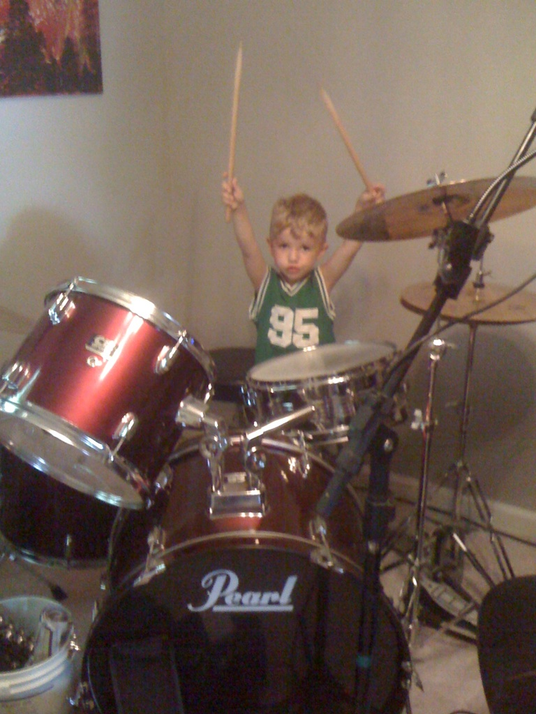 iphone image of boy playing drums
