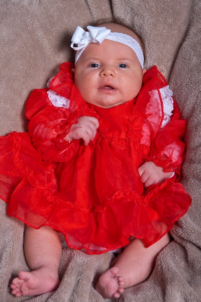 image of baby girl in red dress