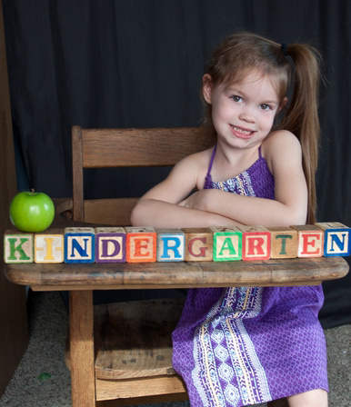image of kindergarten child sitting at old desk
