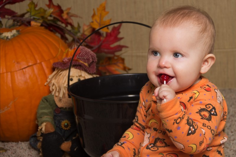 image of infant eating halloween candy