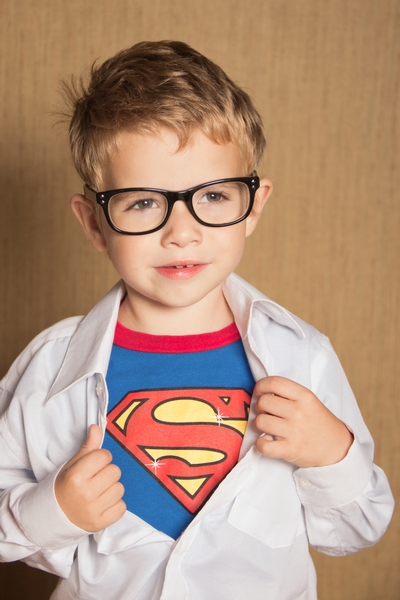 image of little boy dressed like superman