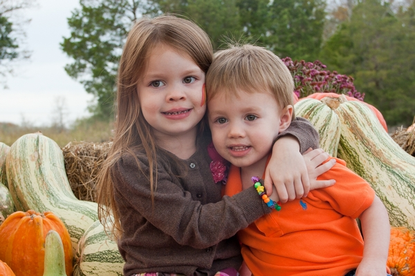 image of siblings at the pumpkin patch